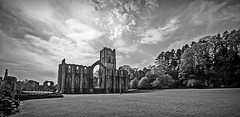 Fountains Abbey (seanfarr) Tags: uk trees england sky heritage history abbey architecture clouds canon landscape eos blackwhite ruins outdoor yorkshire arches historic national trust fountains monastic