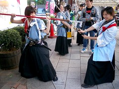 Japanese Samurai Girls Do Battle (crossfire_dave) Tags: festival japan swordfighting samurai shinsengumi japanesegirls matsuri