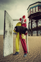 clown in a doorway (matthewheptinstall) Tags: door carnival beach perception costume sinister clown fear digitalart surreal fair accordion creepy doorway entertainer unusual blackpool scaryclown dreamscape darkart evilclown