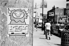 Livin' the dream (solarnu) Tags: bw usa chicago film graffiti sticker hc110 f100 scan il slap expired kodakplusx slaptag iso125 printfilm chicagostreetart konicaminoltadualscaniv expiredin1998 pennypinch pennypinchchi