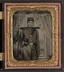 [Unidentified soldier in Union uniform with bayoneted musket in front of painted backdrop showing a window with curtains]  (LOC) (The Library of Congress) Tags: portrait man standing beard uniform union case backdrop libraryofcongress handcolored 1860s bayonet musket xmlns:dc=httppurlorgdcelements11 dc:identifier=httphdllocgovlocpnpppmsca33428