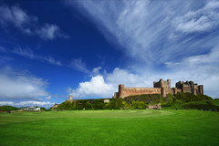 Bamburgh Castle (Philipp Klinger Photography) Tags: uk greatbritain trip travel light vacation england sky cloud sun sunlight holiday green castle nature grass architecture clouds newcastle landscape nikon unitedkingdom britain united great kingdom medieval northumberland filter gb bamburgh philipp cpl
