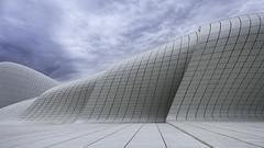 Heydar Aliyev Center #1 (momentaryawe.com) Tags: white architecture clouds europe curves azerbaijan simple minimalist zahahadid momentaryawecom heydaraliyevcenter