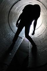 creeping (lyndal.karen) Tags: silhouette dark person weird australia tunnel creepy drain horror canberra thriller