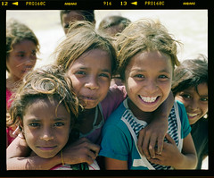 Timor-Leste girls (tsiklonaut) Tags: world poverty girls color dusty 120 film boys smile smiling analog rural pose children asian fun island happy asia fuji child play pentax drum scanner group young scan east negative third pro roll fujifilm medium format enfants analogue 6x7 southeast oriental timor leste 67 kami analogica happyness 160 heureux  c41 chevreau drumscan pmt  pro160c timorese   mme  photomultipliertube  slx2001