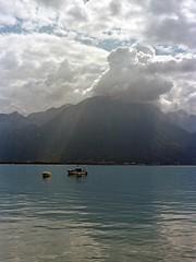 // ciel d'août (Riex) Tags: light lake film clouds 35mm switzerland boat reflex waterfront suisse cloudy kodak lumière lac 10d rays leaded nuages leman subtropical portra beams montreux vaud quais alpa nuageux iso160 plomb faisceaux rivieravaudoise kernmacroswitar50mmf18lens