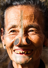 Apatani smile (rob of rochdale) Tags: travel woman india festival tattoo candid teeth culture tribal explore tribe custom neindia ziro apatani noseplugs robhaich