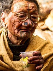 Cheers! (rob of rochdale) Tags: woman india glasses drink ngc culture tribal tattoos homemade age alcohol tradition tribe neindia arunachalpradesh ziro apatani noseplugs ricebeer robhaich