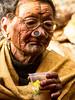 Cheers! (rob of rochdale) Tags: woman india glasses drink ngc culture tribal tattoos homemade age alcohol tradition tribe neindia arunachalpradesh ziro apatani noseplugs ricebeer robhaich