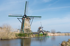 Windmills in Kinderdijk (RuudMorijn) Tags: world sky holland reflection brick heritage mill tourism monument water netherlands windmill dutch architecture reeds landscape boat spring colorful europe european day side seasonal scenic traverse windmills boom historic unesco explore list round mills polder bootje riet banks kinderdijk molen springtime landschap drainage kleurrijk milling windmolen wicks molens vaart zuidholland reflectie stenen voorjaar watermolen spiegeling windmolens poldermill southholland kluut boezem polderlandschap bakstenen rietkraag rijksmonument werelderfgoed anno1738 poldermolen gemetselde grondzeiler nederwaard boezemmolen pwpartlycloudy nederwaardmolennr6 platteschuit