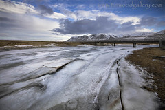FROZEN RIVER, ICELAND 2014. (IMAGES OF WALES.... (TIMWOOD)) Tags: road bridge houses sea mountain lake snow mountains west ice church buildings river boats boat frozen iceland fishing ship hill north hills roads route1 akureyri 2014 akranes stykkisholmur timwood bodeyri stykk