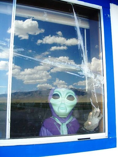 Area 51 alien waving from Little A'Le'Inn - Rachel, Nevada (ashabot) Tags: blue windows nature clouds reflections desert nevada aliens blueskies kitch area51 lookingout nellisairforcebase