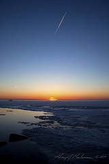Written in the Sky (anakin1814) Tags: sunset lake frozen spring lakemichigan greenbay entrails skywriter wisconson