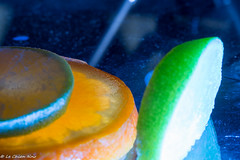 blue lighted fruits (LeChienNoir) Tags: blue orange macro ice fruit canon frozen juicy melting flash filter 2015 100mm28macro lechiennoir canon5dmark3 lechiennoirnl