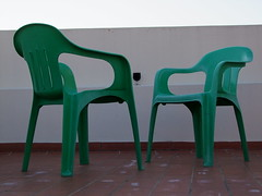 Two green plastic chairs and a glass of wine (cyclingshepherd) Tags: roof red green portugal glass wall rouge chairs wine terrace plastic tiles vin algarve february vinho chaise vino tinto olho 2015 s100fs cyclingshepherd