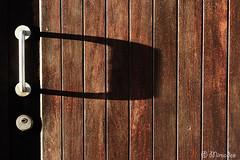 metallic door handle on old door (Mimadeo) Tags: door wood old shadow house texture handle wooden iron closed antique metallic background entrance rusty doorway age aged textured