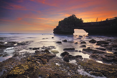Tanah Lot Bali (Adly Wook) Tags: ocean longexposure trip travel light sunset sea sky bali cloud seascape motion texture beach rock stone composition canon indonesia island seaside interesting rocks outdoor fineart tripod filter serene framing tone mossy oversea sighray