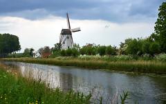 Canal windmill in Damme (wellingtonandsqueak) Tags: windmill canal belgium c1 damme