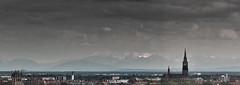 Silence & Splendour (TablinumCarlson) Tags: leica sky mountain alps church skyline clouds germany munich mnchen bayern deutschland bavaria europa europe grain kirche himmel wolken m berge summicron silence crop m8 olympia munchen alpen noise 90mm korn muenchen splendour brd 1158 herrlichkeit ruhe sddeutschland imagenoise bildrauschen