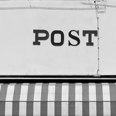 Post (Andrew Malbon) Tags: street leica bw monochrome shopping typography blackwhite post stripes streetphotography rangefinder summicron telephoto shops handheld shopwindow f2 canopy 90mm ran windowshopping capitals m9 singlelens capitalletters 90mmf2 leicam9