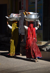(Rick Elkins Trip Photos) Tags: jodhpur rajasthan india woman women walking carrying pot pots head building architecture