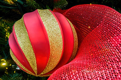 Christmas sphere or bauble (Victor Wong (sfe-co2)) Tags: lighting christmas xmas red orange holiday color yellow bulb silver ball festive season gold golden amber beads globe warm december seasonal decoration celebration ornament sphere ribbon tungsten merry ornamental netting decor bauble