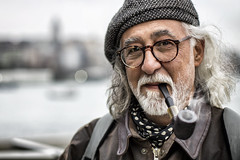 pipe (aglotix) Tags: street old boy portrait man turkey glasses smoke trkiye pipe istanbul human pipo gzlk duman