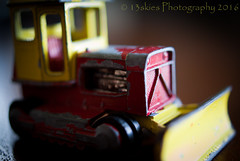 Die-cast toy (HMM) (13skies) Tags: old red macro cars yellow table toys play close small tiny elements bulldozer matchbox metals diecast lesney periodic happymacromonday happymacromondays elementsoftheperiodictable