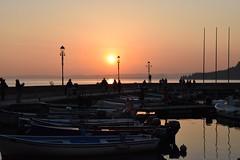 """On the best day, on the worst day, the sun finally sets."" Jeffery Deaver (norella.giorgia) Tags: sunset sky italy sun lake port harbor boat twilight nikon garda tramonto cielo redsky sole redlight lagodigarda d5500 gardaslake"