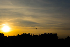 Soaring sphere (alexwinger) Tags: sky sun black yellow clouds buildings evening town away clear sphere rush soar
