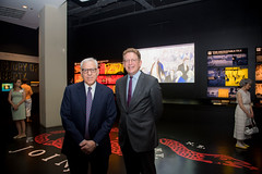 Rubenstein and Herbst pose for a photo at the entrance of the exhibit.