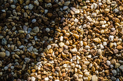 Battle of Light vs Dark (brendan920) Tags: lighting light art nature sunshine dark photography interesting nikon rocks natural outdoor good stones perspective bad battle pebbles symmetry adventure explore half 1855mm 50 infinite gravel versus lightroom d5100