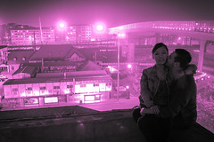 love is in the air... (eric_hevesy) Tags: china street pink light love night kiss couple air dalian intimate
