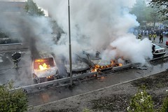 Firemen extinguish a row of burning cars in the Stockholm suburb of Rinkeby after youths rebelled in several different suburbs around Stockholm for a fourth consecutive night, late May 23, 2013. (Pan-African News Wire File Photos) Tags: stockholm swe