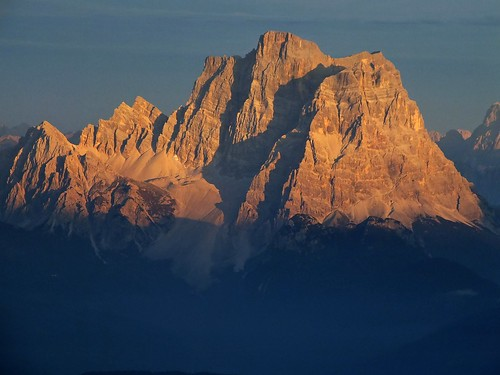 Enrosadira phenomena on Mount Pelmo (3168 m.) heavy zoom from Sass Pordoi (2950 m. Sella Massif, Dolomites)