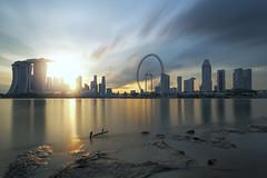 Golden City (My Pixel Magic) Tags: sunset sun reflection skyline marina buildings bay flyer singapore cityscape flare sands sunrays cityview marinabay
