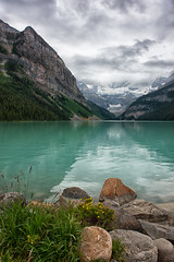 The Calm Shores of Lake Louise (Kristin Repsher) Tags: canada clouds nikon alberta lakelouise banffnationalpark canadianrockies d700 glacierfedlake vision:m