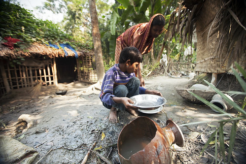 A girl helping her mother with chores in Khulna, Bangladesh. Photo by Felix Clay/Duckrabbit.