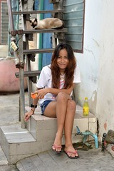 pretty woman on a staircase (the foreign photographer - ) Tags: woman cat portraits thailand energy pretty drink bangkok cigarette young siamese staircase khlong bangkhen thanon