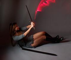 Ragnarök XII: Defense (wirehead) Tags: woman girl model sword ep3 14150mm strobist roselleangel