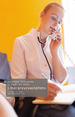 Nurse is speaking on the phone (creativemarket.photo) Tags: portrait people woman white vertical closeup female pen writing work person one call phone desk room telephone young lifestyle professional medical indoors health doctor medicine worker nurse calling job stethoscope onthephone caucasian 2530