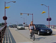 Brian_Annp Biking 1_072808_2D (starg82343) Tags: bridge woman cars bike bicycle lady female lights traffic streetlamps wheels riding gal transportation biker rides annapolis traveling 2d automobiles lampposts brianwallace