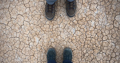 His and Hers (s.d.sea) Tags: road park trip travel vacation texture wall america outside outdoors midwest honeymoon boots pentax hiking interior south central ground roadtrip hike symmetry crack adventure dirt national cover his badlands hers dakota cracked crackle laces