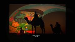 CAMELS CARAVAN (jawadn_99) Tags: blue decorations shadow red sky sun moon men green art colors yellow night photography desert geometry stage performance creative vivid surreal crescent explore camel caravan camels multicolors pinc jawad interrestingness alnajjar