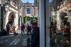 Reflection of musicians @ Leiden (PaulHoo) Tags: city light people urban musician sun holland reflection art window netherlands architecture leiden nikon candid citylife streetphotography streetperformance lightroom 2016 streetcandid d700