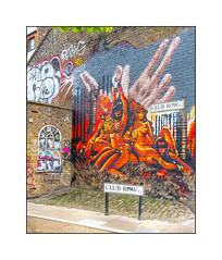 Graffiti (Olivier Roubieu & Jim Vision), East London, England. (Joseph O'Malley64) Tags: uk greatbritain england signs streetart london wall graffiti mural paint britain earth pavement stickers spray british walls cans aerosol cobbles brickwork eastend eastlondon wallmural muralist archedwindow victorianbuilding londonplanetree jimvision olivierroubieu
