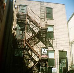197 (Georgie_grrl) Tags: toronto ontario stairs vintage mediumformat shadows patterns steps squareformat fireescape browniehawkeye 197 itshiptobesquare springshootingshenanigans