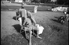 (Enjoy Beer) (Robbie McIntosh) Tags: leicamp leica mp rangefinder streetphotography 35mm film pellicola analog analogue negative leicam analogico blackandwhite bw biancoenero bn monochrome argentique dyi selfdeveloped filmisnotdead autaut candid strangers leicaelmarit28mmf28iii elmarit28mmf28iii elmarit 28mm arsimagofd arsimagofddeveloper arsimagofd159 seaside mappatellabeach rocks lidomappatella ilforddelta100 ilford delta man beer tanninglotion peroni