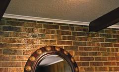 Popcorn Ceiling (rileymillion) Tags: reflection oklahoma mirror fireplace ceiling livingroom brickwall hearth marietta digitalphotography popcornceiling woodbeams mariettaok