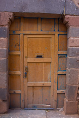 IMG_4355 (monique.timlick) Tags: cusco peru doors brick architecture doorway wood aged weathered historical city urban stonework canon southamerica arch